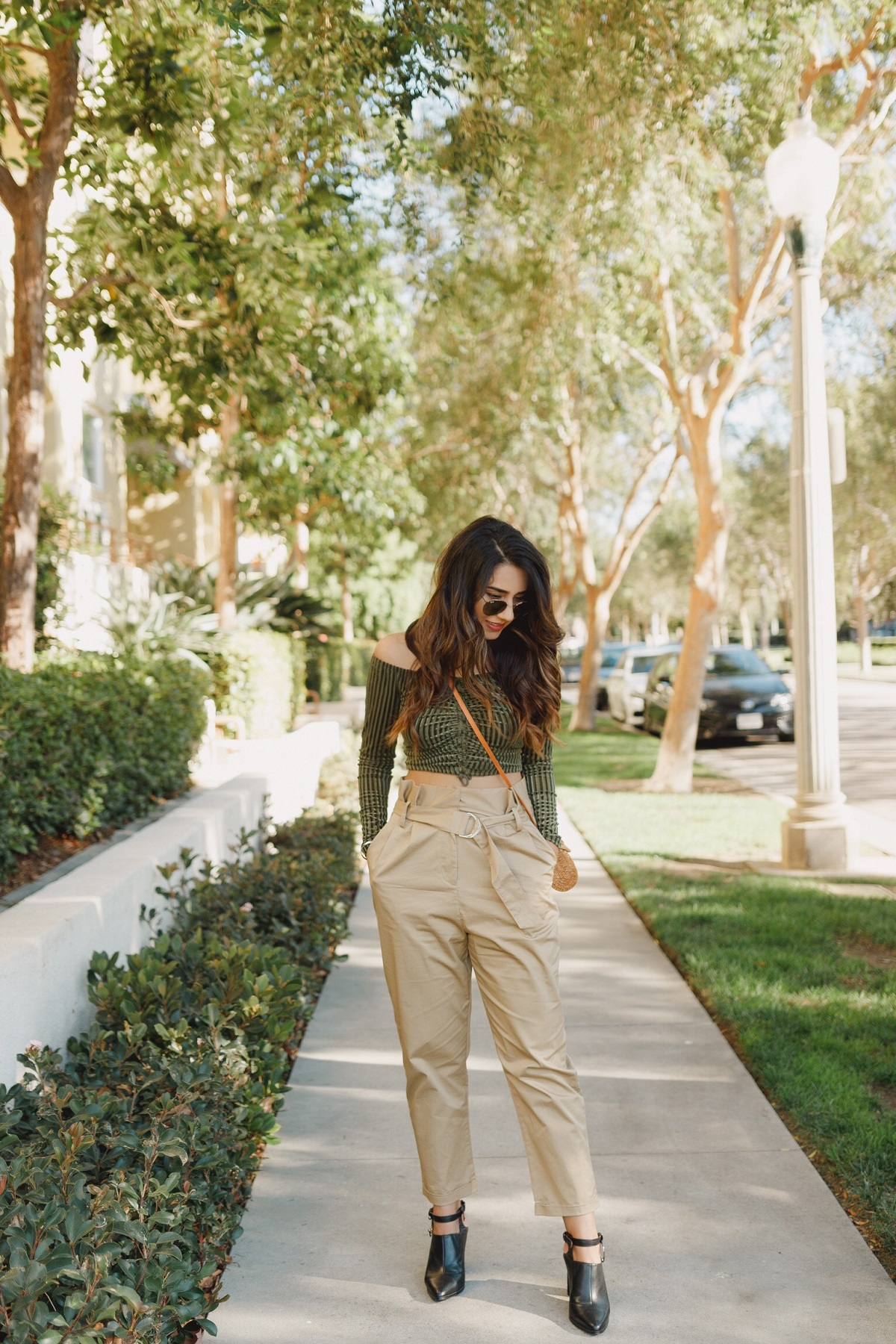 A Stylist's Guide To Wearing High-Waisted Pants